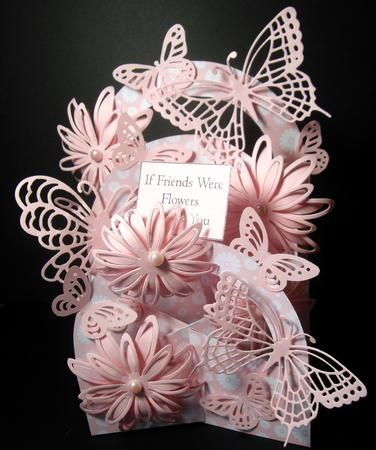 I printed onto pink daisy patterned card and assembled the cascade. I added 3 arches instead of 2 to give a more 3D effect. I added delicate die-cut flowers and 3 delicate butterfly die-cuts. I added smaller punched butterflies to fill in the spaces. I foiled a friends sentiment and fixed it onto an acetate strip so that it swayed in the air, this looks so effective as the acetate is invisible. I added pink pearls to the centre of the flowers to finish off. There are so many possibillities…