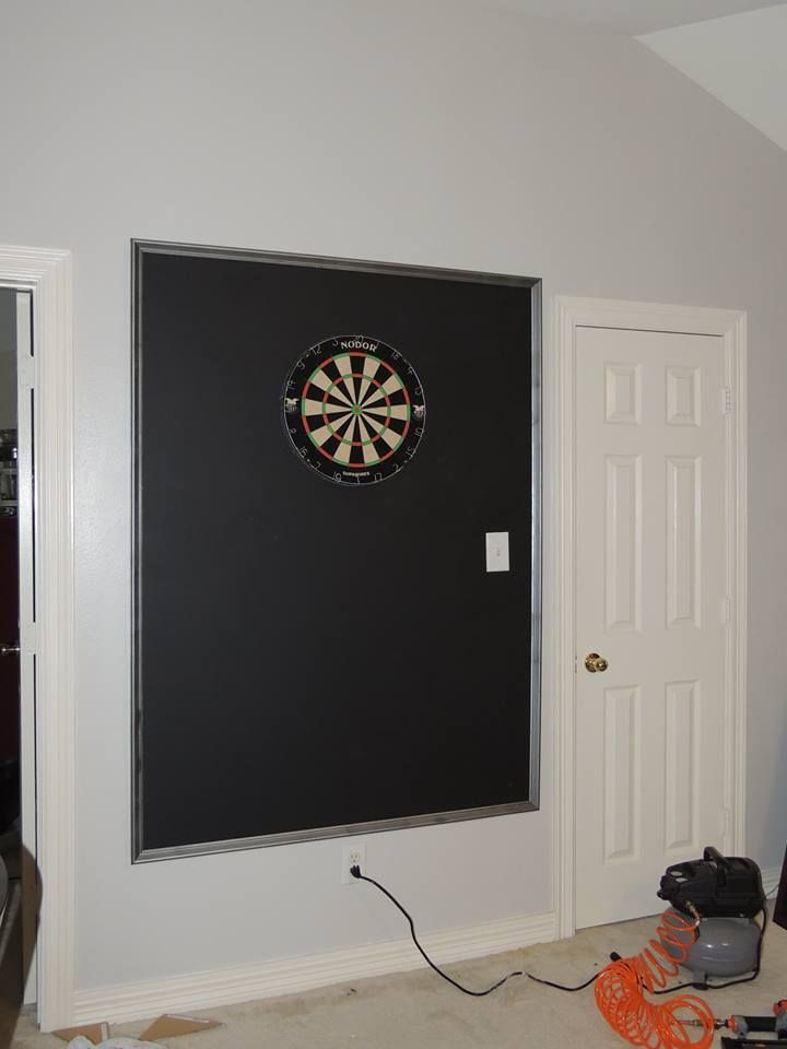 We took a sheet of MDF primed it and painted it with chalkboard paint to put behind our dart board.  This gives us plenty of space for scores and protects the wall.