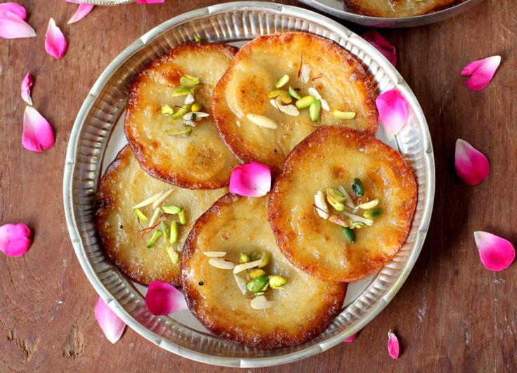 Malpua recipe is one of the special Holi sweet dishes best served with rabri aka rich thickened cream
