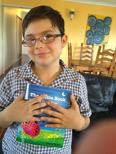 My son holding my new book for the first time.  So exciting.  The Little Book of Harmony!