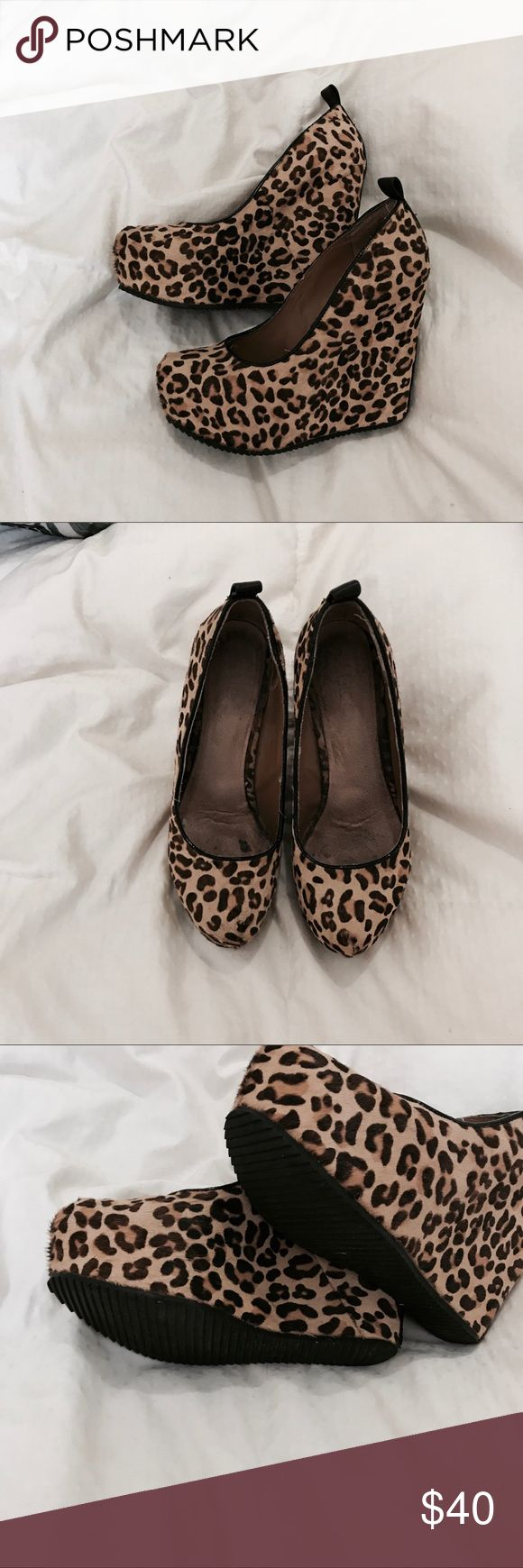 Aldo leopard wedges Leopard wedges with black contrast stripe in back about a 5 inch wedge with platform. Very easy to walk in! Aldo Shoes Wedges