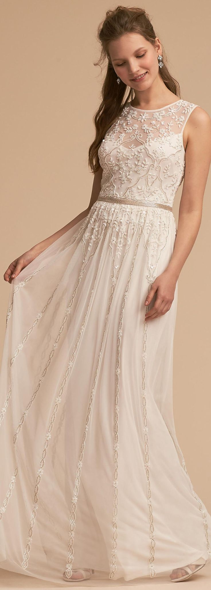 This chiffon maxi bridal gown features a highneck illusion