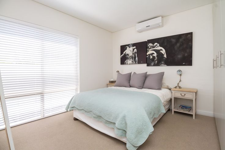 The main bedroom has an en-suite bathroom which consists of similar finishes to the other but has a shower instead.