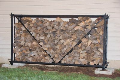The rack's overall dimensions are 8 ft wide x 4 ft high x 2 ft deep and it comfortably holds a 1/2 cord of split wood.