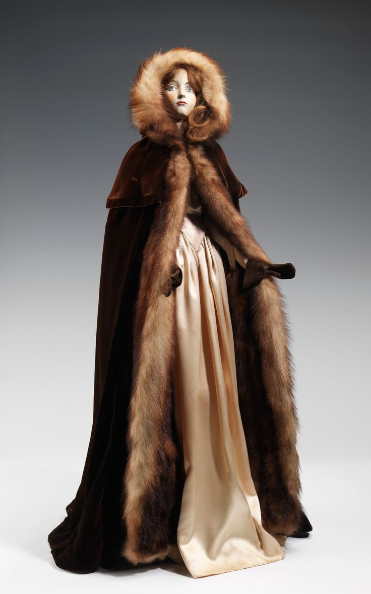 """""""1755 Doll"""" by A. Reichart, 1949  From the Metropolitan Museum of Art  This design by the furriers Blondell is credited as being a """"Manon Lescaut"""" style. """"Manon Lescaut"""", published by Antoine Françoise Prévost in 1731 typifies the lyrical emotion of rococo literature and inspired several stage productions including a ballets and operas by Massenet and Puccini."""