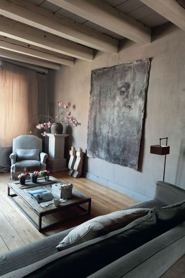 French Living Room - love this small French townhouse. Interesting Artwork - subtle grey tones in room.