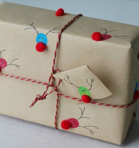 Use fingerprints to make reindeer gift wrap