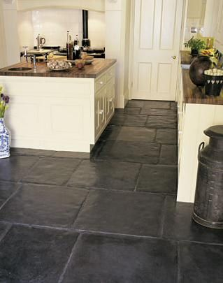 Deep slate floor sets off the cream counter tops. http://www.artofclean.co.uk/slate-and-sandstone-cleaning/