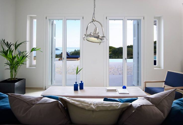 Navy colours...blue and white decorative designs combined with white windows and doors, create an ideal summer destination! #interSCALA #wood #frames #windows #doors