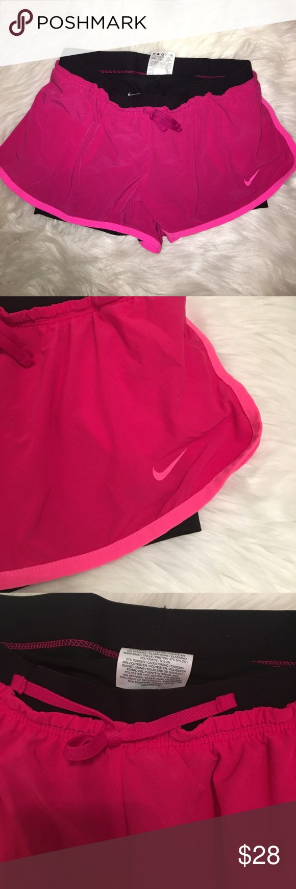 Nike Running Shorts and Spandex This hot pink Nike running shorts have black spandex built into them! Super convenient because it's two purchases in one and fits more comfortable. They're too small on me so I've only worn them once. Dri-Fit material. Nike Shorts Jean Shorts