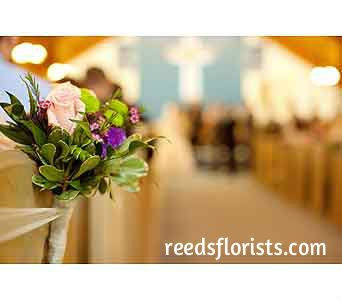 Beautiful accents in the church. Created exclusively by our experienced designers. reedsflorists.com