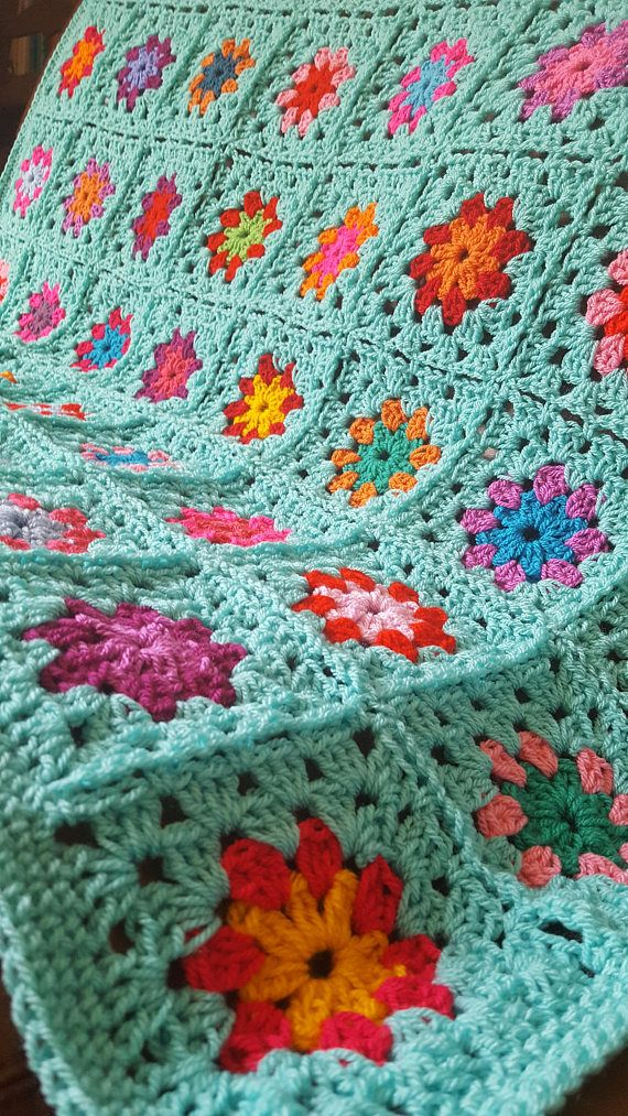 Made to order. Hand MADE not manufactured A gorgeous summertime handmade crochet granny square blanket. The blanket is constructed from 8 rows of 8 squares across - so 64 in total and is bordered with orange trim and assorted colors of granny squares. Perfect for the home on the sofa in