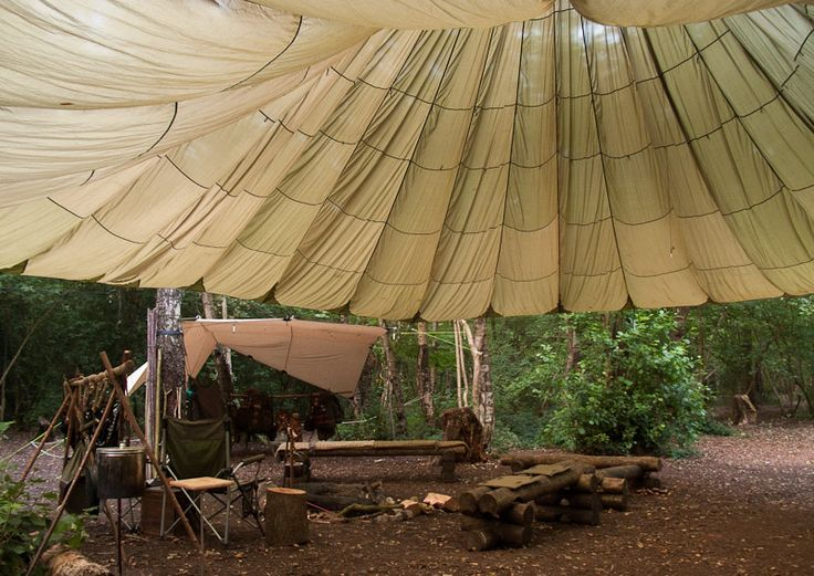 parachute bushcraft base camp shelter - love this for an outdoor party or for an indoor temporary ceiling treatment.