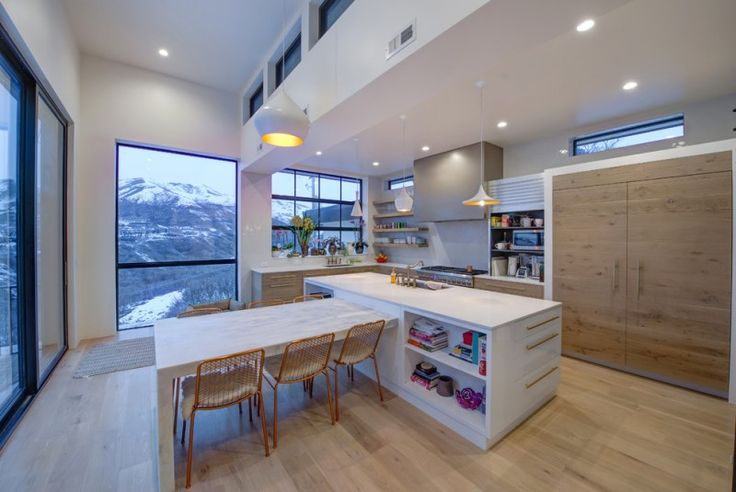 minimalist kitchen white minimalist kitchen island included with open shelves flat panel cabinetry and undermount sink light wood floors light wood dining tables with chairs L shape & white counterto of Tens of Inspiring Kitchen Islands with Storage and Chairs