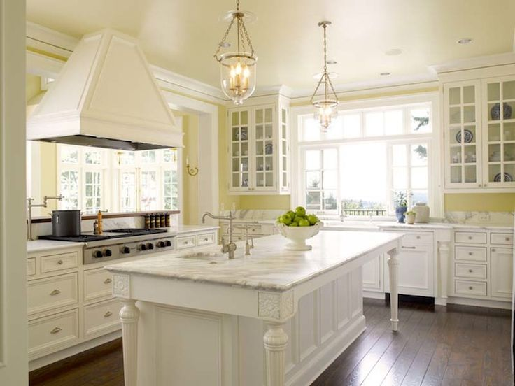 Kitchen Paint Colors: 10 Handsome Hues For Hardworking Spaces   Pale Yellow  Walls, Glass Front Cabinetry, Antique White Paint For Lower Cabinets Part 58