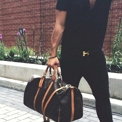 Hermes belt, Vuitton bag, biceps .... looks like HIM