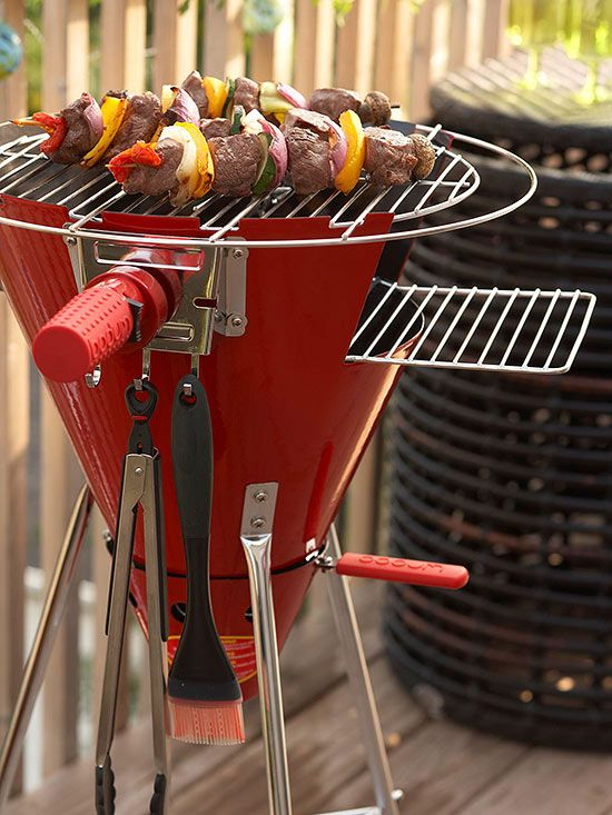 Turn Up the Heat: This funky, colorful charcoal grill delivers space-saving fun. Perfect for preparing dinner for two to four people, the cone-shape cooker features clever storage hooks for stowing cooking utensils. | Tiny Homes