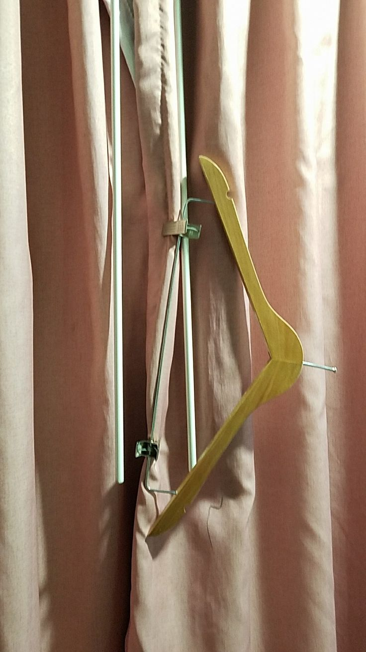 Motel room hack: When the curtains don't stay closed on their own. Most motel rooms supply hangers with clothes pins. Works great on cheap motel curtains!