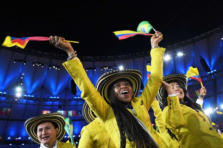 Colombia strong:     Members of the Colombia delegation wave flags during the opening ceremony of the Rio 2016 Olympic Games at the Maracana stadium in Rio de Janeiro on Aug. 5, 2016