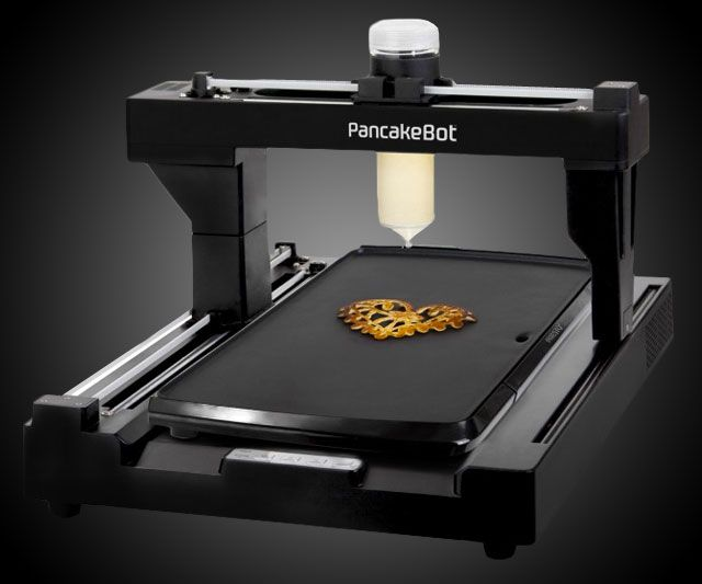 Turn a Picasso...or your own boobie scribbles...into edible, delectable art with the PancakeBot, the world's first pancake printer, and the world's latest entirely unnecessary invention! Mama! I'm tired of circles and your lame attempts at hearts! Today