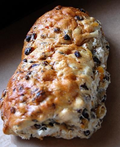 Fruit Bread (Dried fruits)-- 1 package active dry yeast ¼ cup warm water, about 105 to 110 degrees 1/3 cup unsalted butter ¾ cup whole milk, 2 tsp. each vanilla extract & good brandy(Mi) 1/3 cup granulated sugar 1 teaspoon salt 2 large eggs, beaten 2 cups all-purpose flour 2 cups bread flour ¼ cup golden raisins ¼ cup dark raisins ¼ cup chopped dried apricots ¼ cup dried currants melted butter Soak the dried fruits in water & liqueur mix first.