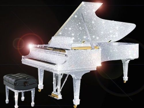 CrystalRoc Piano is completely covered with Swarovski crystals. I would love this to light the living room.
