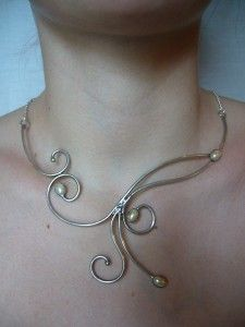 Pretty graceful necklace. I feel like this style fits this board.