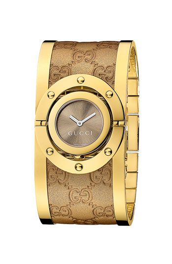 A bold Twirl collection watch that proudly flaunts Gucci's iconic style and unforgettable creativity. | Yellow gold PVD-plated stainless steel and Guccisima leather bangle bracelet | Rotating round ye