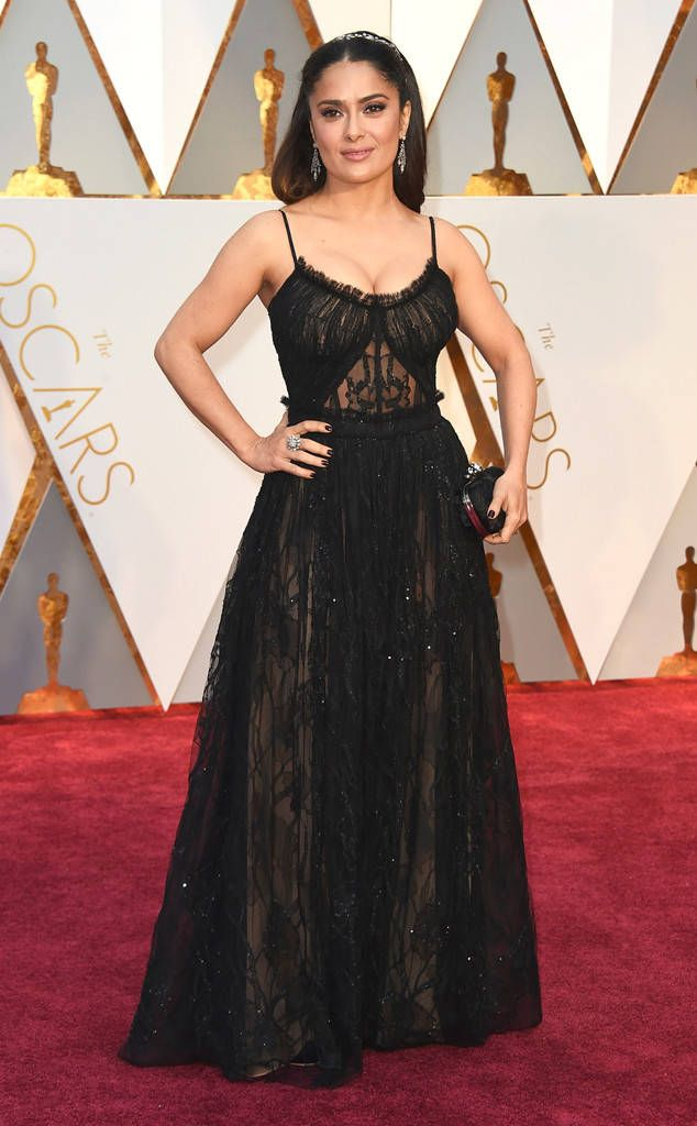 Salma Hayek from Oscars 2017: Best Dressed Women  In all-black it's sometimes difficult to show personality, but Salma's Alexander McQueen gown has so many subtle details that make it unique.