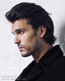 Hairstyle for men with long hair. Modern style haircut with back swept hair.