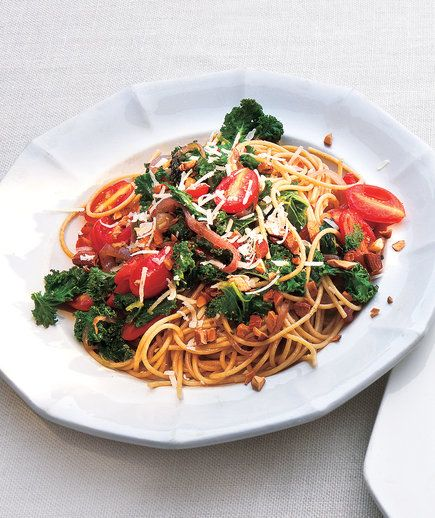 Whole-Grain Spaghetti With Garlicky Kale and Tomatoes | Round out your main course with this nutritious leafy green, or add it to soups, stews, and even smoothies for a healthy boost.