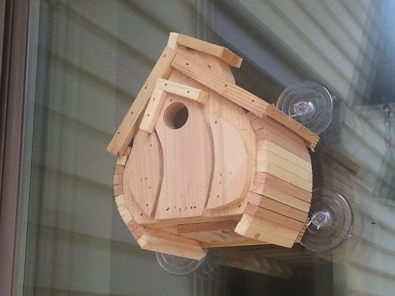 Barrel  This bird house is made to mount on your window. It has a opening on the back so you can see inside the bird house. Its made of Cedar