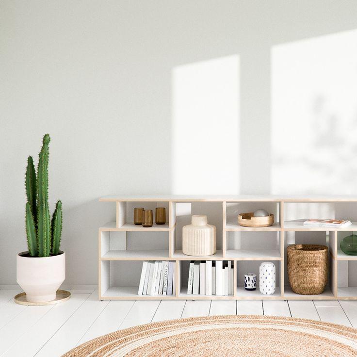 wooden plywood designer modular wall storage bookshelf in a modern home interior