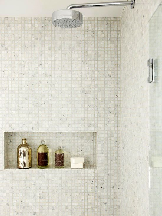 recess in shower--like that is it rectangular and not the typical square ones that we often seen.  For a high-low look, I would do subway tiles with a touch of marble within the niche itself only.: