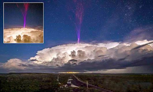 Forget purple rain, it's purple lightning! Photographer captures a rare weath...