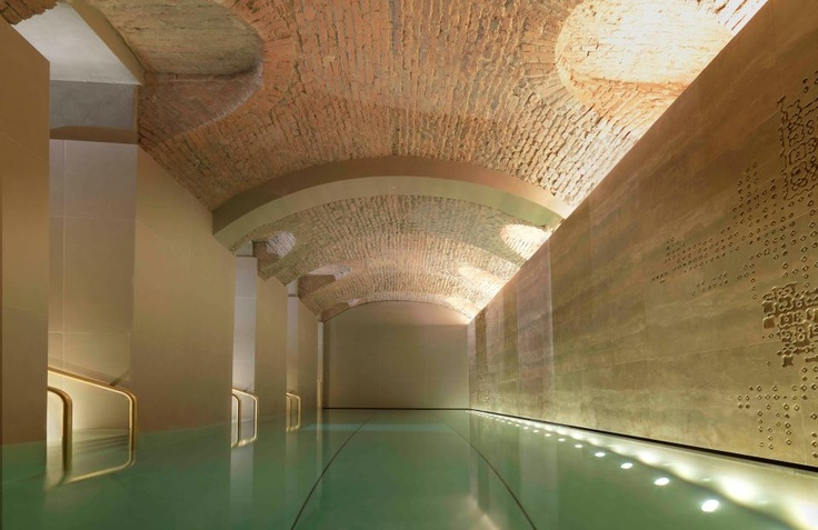 @Four Seasons Hotel Milano's stunning 42-square-metre pool is set in a double gallery beneath a vaulted brick ceiling.