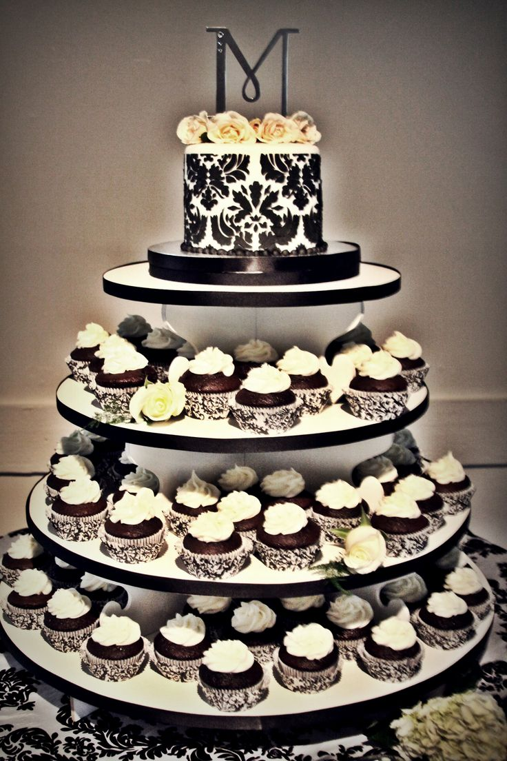 Andrea - 6 inch black and white damask cake with 100 chocolate banana cupcakes with cream cheese icing