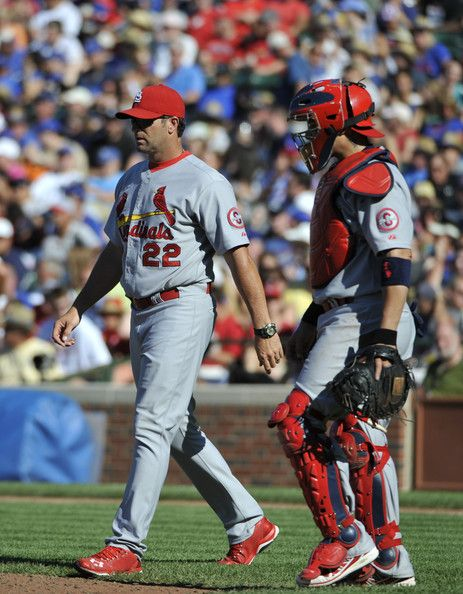 Mike Matheny Photos - Mike Matheny #22 of the St. Louis Cardinals and Yadier Molina #4 walk to the mound to make a pitching change during the sixth inning on July 12, 2013 at Wrigley Field in Chicago, Illinois. - St Louis Cardinals v Chicago Cubs