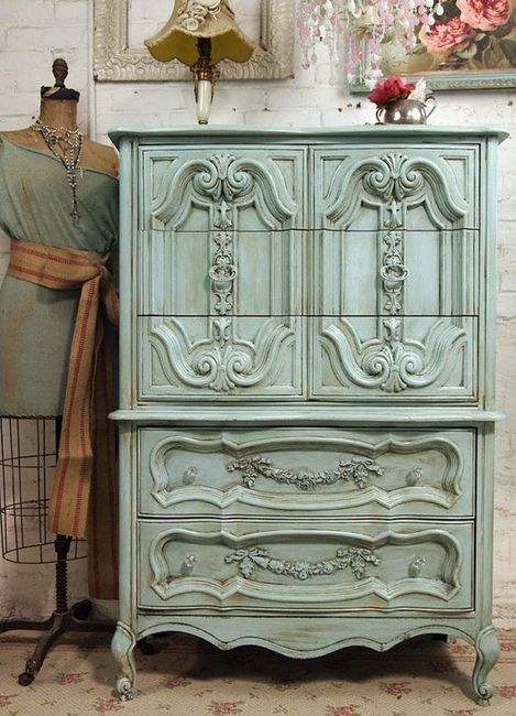 I love the patterns on this wardrobe. I would love to see it against white, rustic wall and shabby floor.