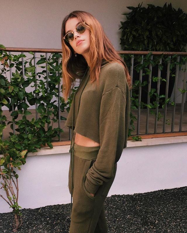 If there's one thing we know about street style right now, it's that hoodies are back in a major way. Remember when we showed you how to style one for almost any occasion? Well, our latest styling trick is here, and it's easier than ever.  The idea came to us from up-and-coming model Kaia Gerber's latest Instagram snap, thanks to a tip from InStyle. The model showed off a chic olive-green sweatsuit with one important detail-the hoodie's cut-off hem. You could crop off the bottom of one…