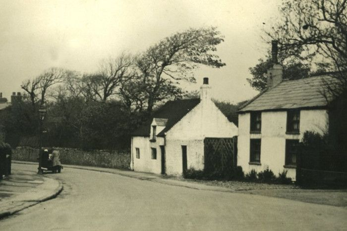 Whitewashed Cottages on Layton Road looking from the direction of it's junction with Newton Drive
