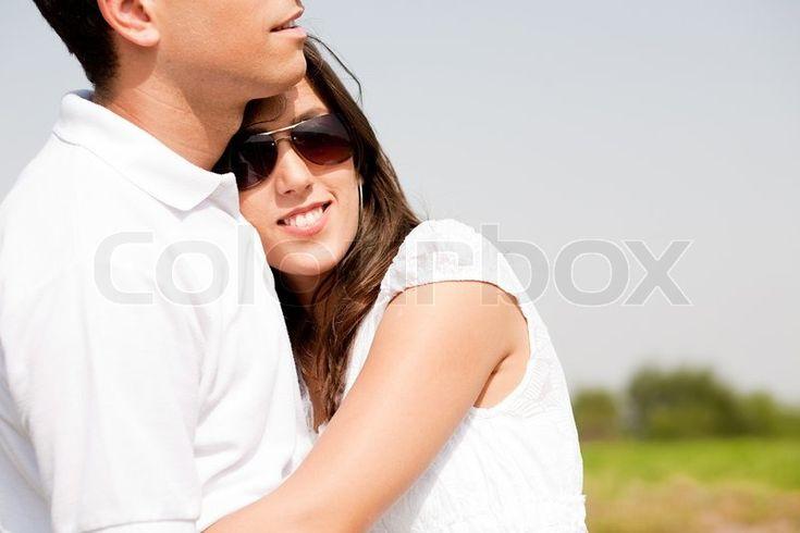 Closeup Portrait Of A Cute Couple Hugging , Focus On Female ...