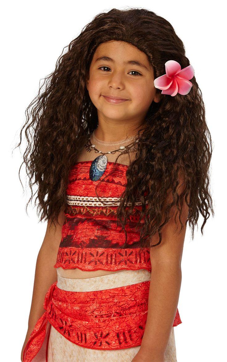 Vaiana-peruukki. Tumman ruskea kiharainen lasten peruukki kukkakoristeella.