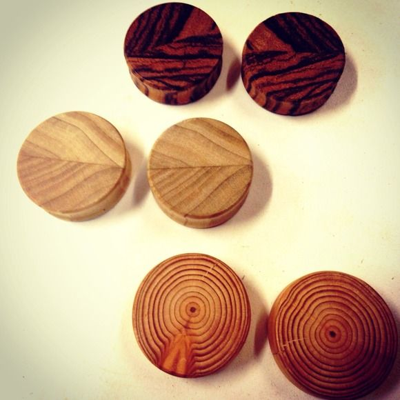 "Handmade wooden plugs Offering a variety of handmade organic wooden plugs. We use a fun and colorful pallet of all different kinds of wood to create these beautiful one of a kind plugs. Currently sizes 1/2""- 1 9/16"" are available. There are many advantages to using wood as opposed to acrylic or metal, one being, they just let your ears breathe! All products made in Bigfork, MT. handmade Jewelry"