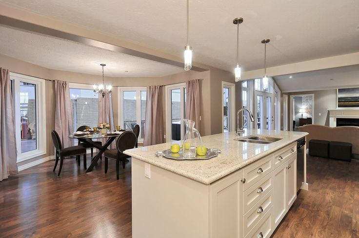 The Trent - kitchen opens up to the dining nook with lots of windows...nice & bright.  Imagine the lake or waterfront view...  www.qualityhomes.ca