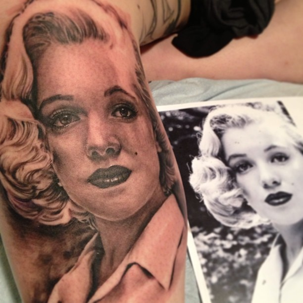 Marilyn Monroe portrait done by my very skilled father Jeff Gogue. She is on me! Part of a classic Hollywood leg sleeve we are working on. This photo was taken after the first session done the day before i turned 20. We placed her based on her beauty mark was one of my own. We took it as a sign she was meant to be there.