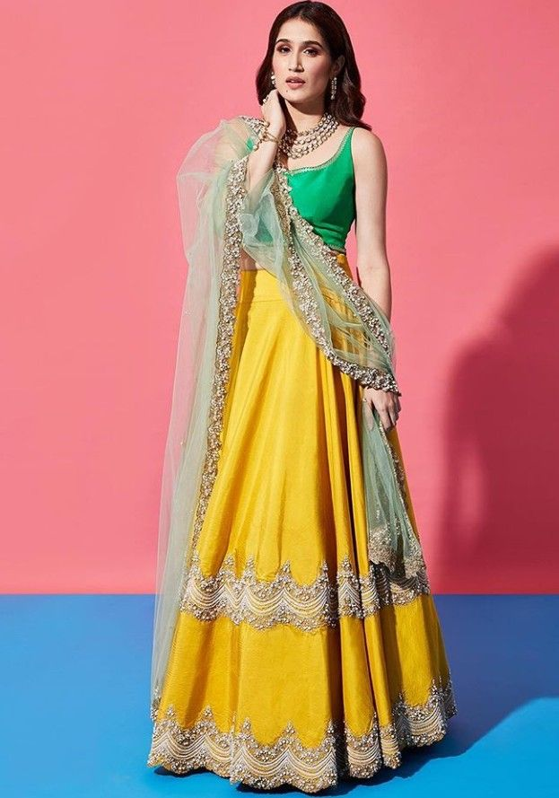 fafcbf788a21 Beautiful Silk-Satin Lehenga-Choli with beautiful embroidery and embellished  net dupatta.