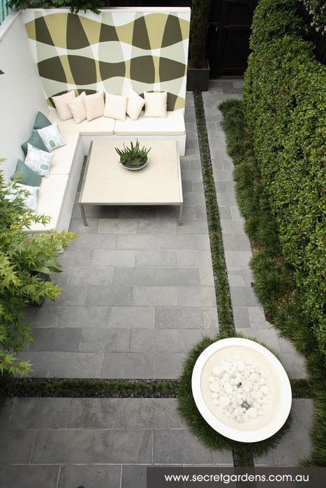 Modern garden design. Love the Mondo grass border contrasting the grey paving stone.