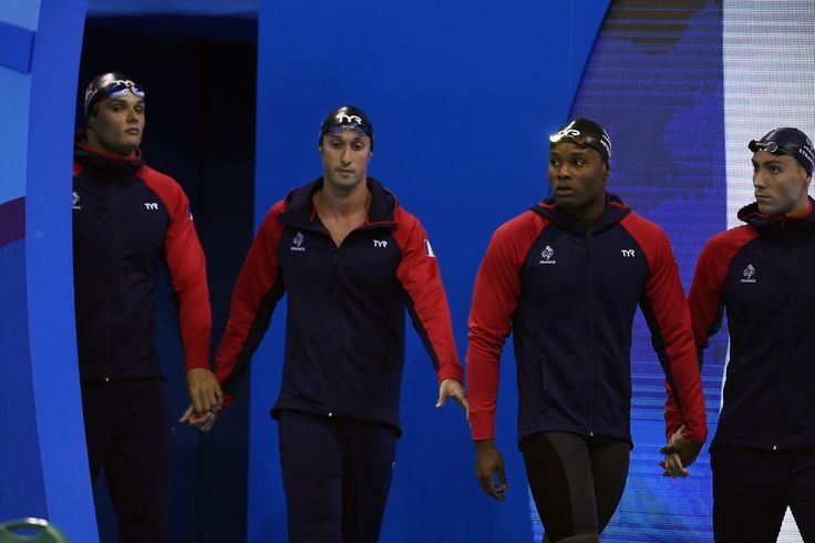 (FromL) France's Florent Manaudou, France's Fabien Gilot, France's Mehdy Metella and France's Jeremy Stravius arrive to compete in the Men's 4x100m Freestyle Relay Final during the swimming event at the Rio 2016 Olympic Games at the Olympic Aquatics Stadium in Rio de Janeiro on August 7, 2016.   / AFP / GABRIEL BOUYS