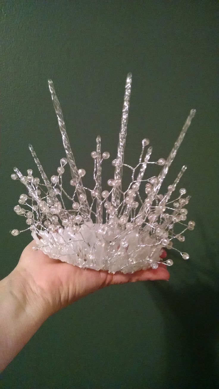 My version of the Snow Queen's crown.  The base was a crystal costume tiara,glass icicles, some floral beadery, and lots of hot glue.